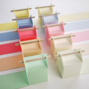 Tone-on-tone, pastel colored favor boxes